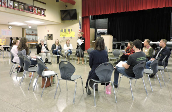 "This Times-Leader photo shows a practically empty ""listening session.""  The anti-fracking Ohio Environmental Council gives a presentation along with activist Julie Weatherington-Rice."